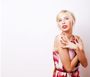 Young pretty blonde girl presenting something at white copy spac Stock Images