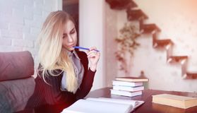 Young pretty blonde girl student. Before classr stock images