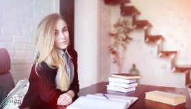 Young pretty blonde girl student. Before classr royalty free stock photos