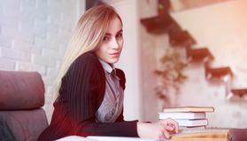 Young pretty blonde girl student. Before classr stock photo