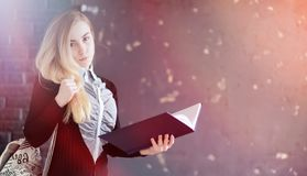Young pretty blonde girl student. Before classr royalty free stock photography