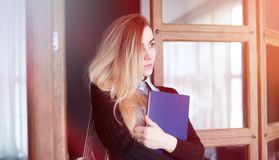 Young pretty blonde girl student. Before classr stock photography