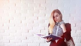 Young pretty blonde girl student. Before classr royalty free stock images