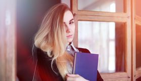 Young pretty blonde girl student. Before classr stock photos