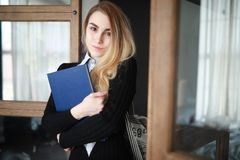 Young pretty blonde girl student. Before classr royalty free stock image