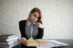 Young pretty blonde girl student. Before classr stock image