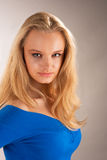 Young pretty blonde with passion look. Isolated on gray background royalty free stock images