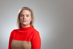 Young Pretty Blonde Startled Girl in Sweater Royalty Free Stock Photo