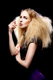 Young pretty blonde woman with big hair fashion Royalty Free Stock Image