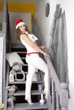 Young pretty blonde woman in New Year decorations Stock Photography