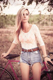 Young pretty blonde woman posing  in summer sunshine Royalty Free Stock Images