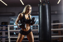 Young pretty boxer woman standing on ring Stock Image