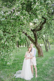 Young pretty bride in wedding dress with handsome groom outdoors Stock Photography