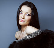 Young pretty brunett woman dressed stylish in fur Stock Photos