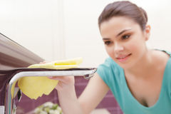 Young pretty brunette cleaning tap Stock Photos