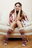 Young pretty brunette girl in Christmas ornament blanket getting warm on cold winter, freshness beauty concept Royalty Free Stock Image