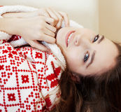 Young pretty brunette girl in Christmas ornament blanket getting warm on cold winter, freshness beauty concept Royalty Free Stock Images