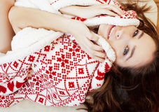 Young pretty brunette girl in Christmas ornament blanket getting warm on cold winter, freshness beauty concept Stock Images