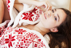 Young pretty brunette girl in Christmas ornament blanket getting warm on cold winter, freshness beauty concept Stock Photography