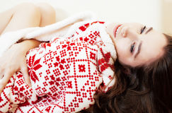 Young pretty brunette girl in Christmas ornament blanket getting Royalty Free Stock Photos