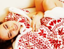Young pretty brunette girl in Christmas ornament blanket getting Stock Images