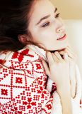 Young pretty brunette girl in Christmas ornament blanket getting Stock Photography