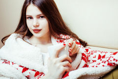 Young pretty brunette girl in Christmas ornament blanket getting warm on cold winter, freshness beauty concept Royalty Free Stock Photos