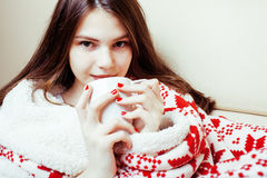 Young pretty brunette girl in Christmas ornament blanket getting warm on cold winter, freshness beauty concept Royalty Free Stock Photography