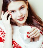 Young pretty brunette girl in Christmas ornament blanket getting warm on cold winter, freshness beauty concept Stock Photo