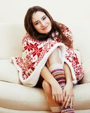 Young pretty brunette girl in Christmas ornament blanket getting Stock Photo