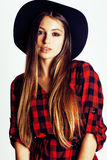 Young pretty brunette girl hipster in hat on white background casual close up dreaming smiling. real american modern Royalty Free Stock Photos