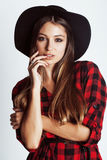 Young pretty brunette girl hipster in hat on white Stock Photo
