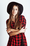 Young pretty brunette girl hipster in hat on white Stock Images