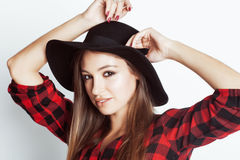 Young pretty brunette girl hipster in hat on white Royalty Free Stock Images