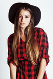 Young pretty brunette girl hipster in hat on white Royalty Free Stock Photo