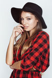 Young pretty brunette girl hipster in hat on white Stock Photos