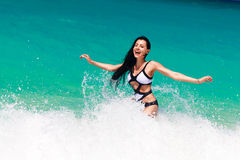 Young pretty brunette with long hair in black and white swimsuit Royalty Free Stock Image
