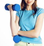 Young pretty brunette woman with blue dumbbell isolated cheerful smiling, part of body, diet people concept on white Stock Images