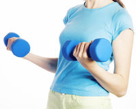 Young pretty brunette woman with blue dumbbell isolated cheerful smiling, part of body, diet people concept on white Stock Photos