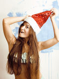 Young pretty brunette woman in christmas red hat Royalty Free Stock Images
