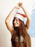 Young pretty brunette woman in christmas red hat Stock Photos