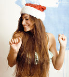 Young pretty brunette woman in christmas red hat Stock Photo