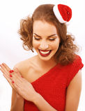 Young pretty brunette woman in christmas red hat Stock Image