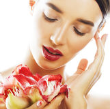 Young pretty brunette woman with red flower amaryllis close up i Stock Photo
