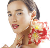 Young pretty brunette woman with red flower amaryllis close up isolated on white background. Fancy fashion makeup Royalty Free Stock Image