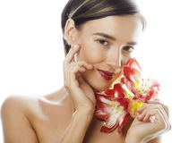 Young pretty brunette woman with red flower amaryllis close up isolated on white background. Fancy fashion makeup Stock Photo
