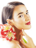 Young pretty brunette woman with red flower amaryllis close up isolated on white background. Fancy fashion makeup Royalty Free Stock Photography