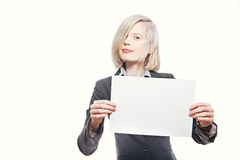 Young pretty buisnesswoman hold a white sheet of paper Royalty Free Stock Photos