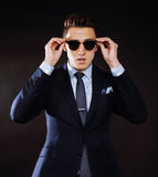 Young pretty business man standing on black Royalty Free Stock Image