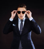 Young pretty business man standing on black Royalty Free Stock Photography